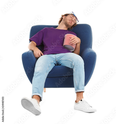 Man with 3D glasses and popcorn sleeping in armchair during