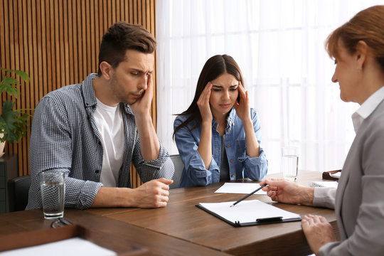Lawyer having meeting with young couple in office