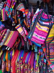 Background of colored fabrics from a traditional ethnic market.