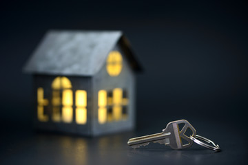 House keys with house model on the background