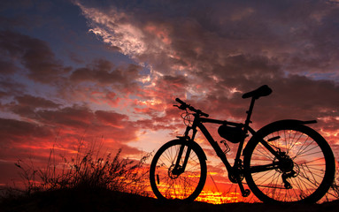 bike in the background fire sunset.