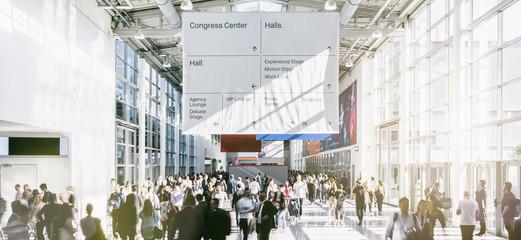 Fototapete - crowd of trade fair visitors walking in a clean futuristic corridor