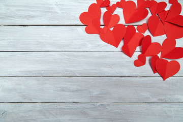 Red paper hearts on white wood Valentine's Day