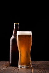 Photo of buttle and glass of beer