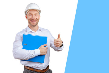 Happy young businessman architect smiling