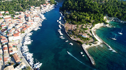 Aerial drone photo of iconic seaside village of Gaios, a safe harbor for yachts and sailboats, Paxos island, Ionian, Greece