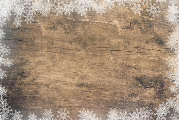 an old wooden background and snowflakes