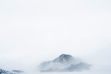 Mountain in winter storm.  clouds in the mountains. Minimalist landscape