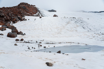 Snow and ice landscape in Caucasus mountains in cloudly weather