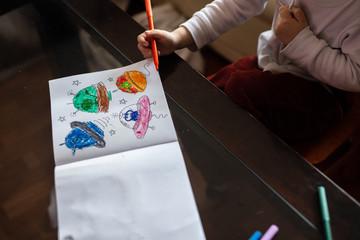 little boy drawing aliens