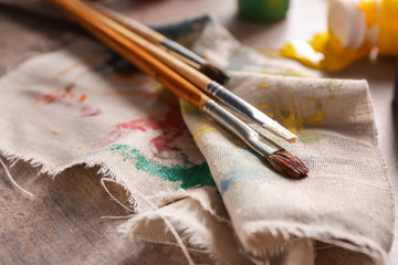 Brushes with paints on cloth