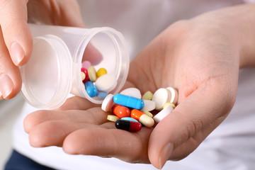Woman with pills, closeup