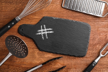 Composition with kitchenware and hashtag sign on wooden background