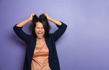 Screaming young woman on color background Wall mural