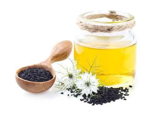 Black cumin oil on white background