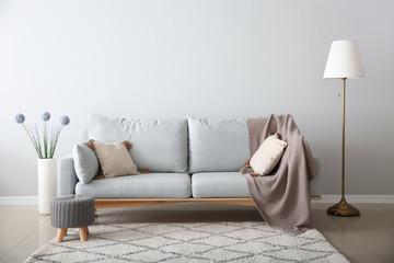 Soft sofa in interior of living room