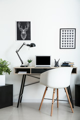 Stylish workplace with laptop in room