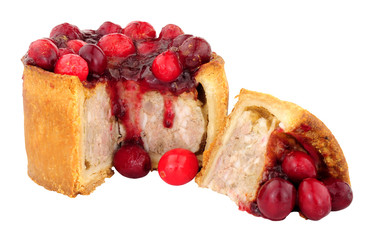 Pork pie topped with cranberries isolated on a white background