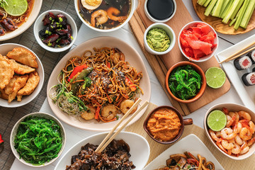 Assortment of Chinese food on white table Wall mural