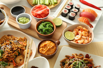Assortment of Chinese food on white table