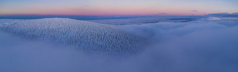 Wall Mural - Aerial view of European winter snowy landscape