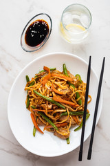 Asian noodles with pork in teriyaki sauce, with green beans, carrots and shiitake mushrooms.
