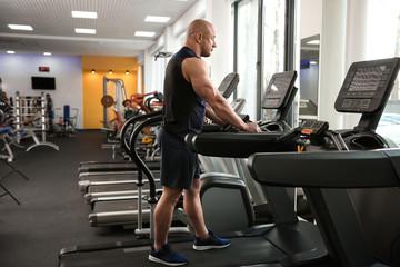 Muscular man training in gym