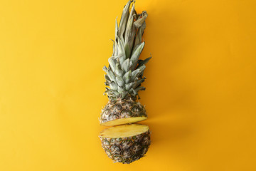 Ripe cut pineapple on color background