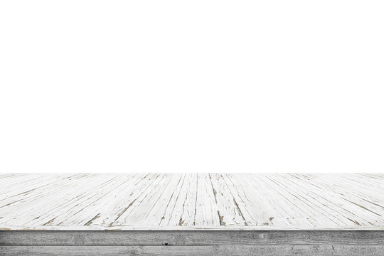 Wooden stage of planks with pealing white paint