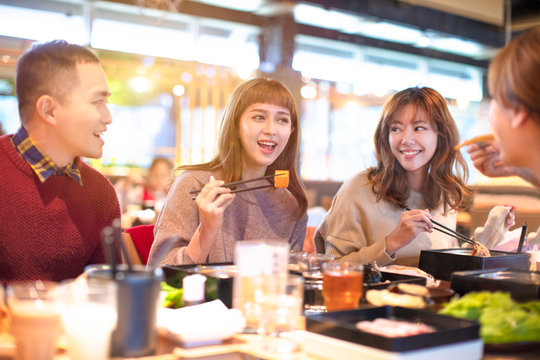 happy asian young Group  eating in the restaurant