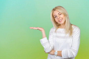 Caucasian isolated blond woman presenting with her hands
