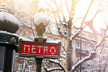 Famous Parisian metro sign covered with snow Wall mural