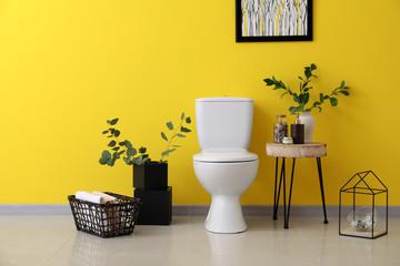 Modern interior of restroom with ceramic toilet bowl