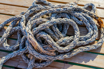 Coiled rope on jetty