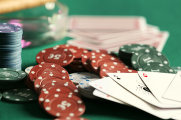 Chips and cards on table in casino