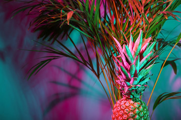 Fresh pineapple and tropical palm on color background Wall mural