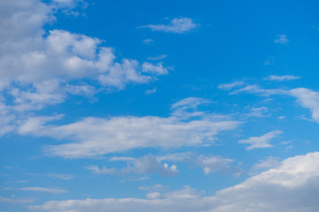 Beautiful blue sky with clouds and sunlight.