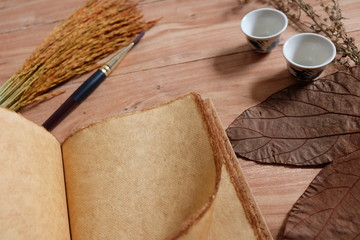 Autumn composition,autumn leaves and paintbrush  on wood background. Flat lay, top view, copy space - Image