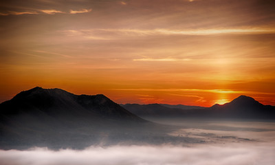 Morning atmosphere at Mueang Loei Chiangkhan with warm tone and mountain range covered with fog
