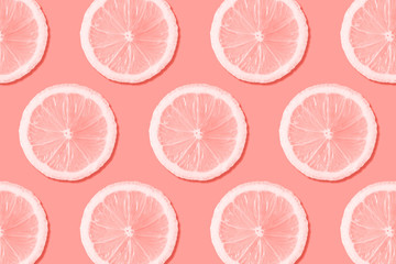 Assorted sliced fruits concept. Coral color background. Wall mural