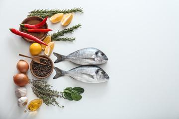 Fresh dorado fish and ingredients on white background