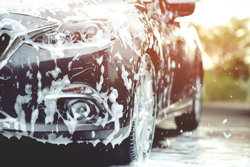 Outdoor car wash with foam soap. Wall mural