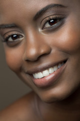 Close up beauty picture of a beautiful, young, black woman with a big smile.
