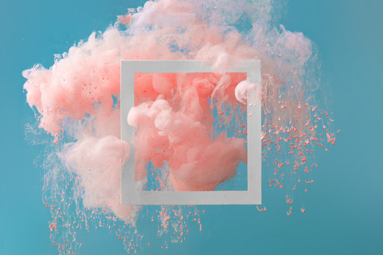 Abstract pastel pink color paint with pastel blue background.. Fluid composition with copy space. Minimal natural luxury.