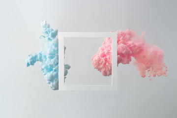 Abstract pastel pink and blue color paint with pastel gray background. Fluid composition with copy...