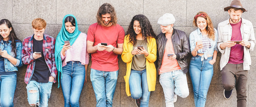 Group of millennial friends watching social story on smart mobile phones