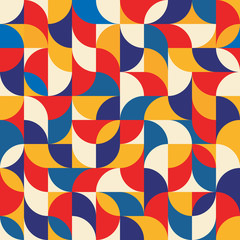 Abstract geometric background - seamless vector pattern illustration in blue, red and yellow colors. Mosaic ornament structure.