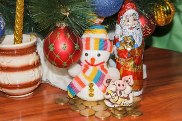 Christmas and New Year card with cute pig, snowman and Santa Claus. Ornaments symbol of the year on the Chinese calendar ate in the background. Winter holiday concept