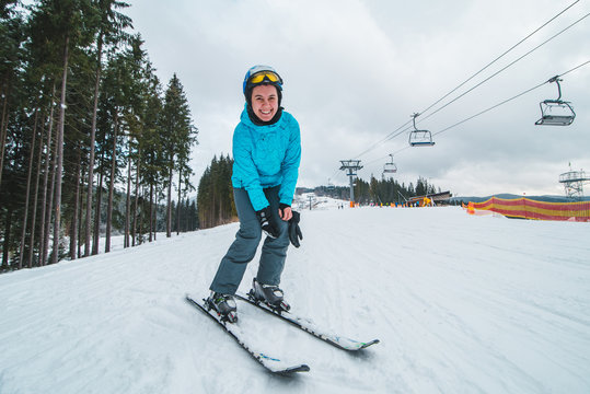 wide angel picture of skiing young adult woman