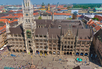Great aerial view of Munich's New Town Hall (Neues Rathaus) and Mary's Square (Marienplatz), the popular pedestrian zone with the Marian column (Mariensäule) and the fountain Fischbrunnen.